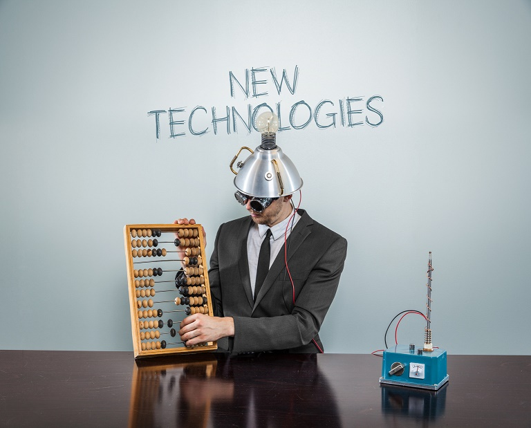 New technologies concept with vintage businessman using abacus
